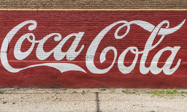 An old, painted Coca-Cola sign on the side of a building in the town of Grand Saline in Van Zandt County, Texas