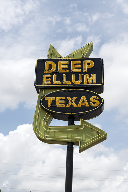 An old-style neon place marker for Deep Ellum, a neighborhood composed largely of arts and entertainment venues near downtown in Old East Dallas, Texas