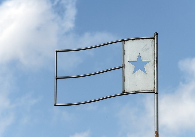 An unusual representation of the lone-star Texas State Flag, minus its usual red, white, and blue colors, on a street in Amarillo, Texas