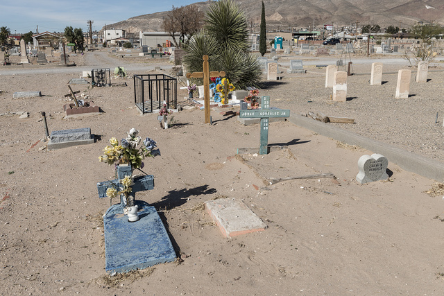 "Called ""El Paso's Boot Hill,"" Concordia Cemetery contains the remains of more than 60,000 people, including black ""buffalo soldiers"" (whose headstones are shown here), Mormon pioneers, Texas rangers, and gunfighters, including John Wesley Hardin. El Paso, Texas"