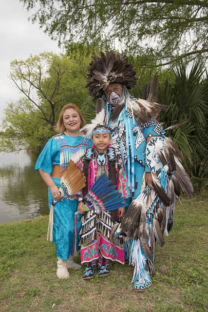Calvin Osife, whose heritage traces to the Navajo people of Chinle, Arizona, pictured with his wife, Jennifer, and daughter, Dakota Prairie Rose, at the Celebrations of Traditions Pow Wow, an official Native American Pow Wow that is part of the annual, month-long Fiesta San Antonio in Texas