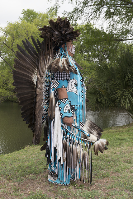 "Calvin Osife, whose heritage traces to the Navajo people of Chinle, Arizona, wears a traditional ""jingle dress"" at the Celebrations of Traditions Pow Wow, an official Native American Pow Wow that is part of the annual, month-long Fiesta San Antonio in Texas"