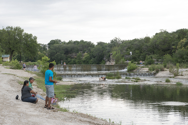 Citizens enjoy an outing on Lake Georgetown and its small dam on the San Gabriel River at Georgetown in Williamson County, Texas