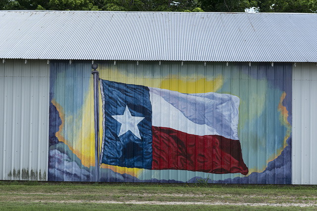 Colorful depiction of the Texas Lone Star flag in a mural on a building in Terrell, Texas, east of Dallas