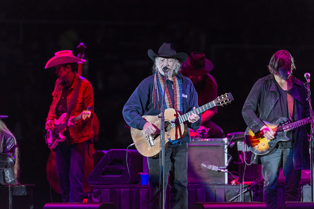 """Country singer-songwriting legend Willie Nelson, age 80 at the time of this photograph, performs with his band, """"Family,"""" at Rodeo Austin, the city's annual stock show and rodeo"""