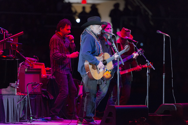 "Country singer-songwriting legend Willie Nelson, age 80 at the time of this photograph, performs with his band, ""Family,"" at Rodeo Austin, the city's annual stock show and rodeo. The fellow in the fedora, introduced to the audience only as ""Johnny,"" is Hollywood actor Johnny Depp, himself an accomplished guitarist"