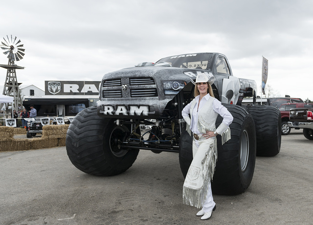 Cowgirl Karen Bernard promotes a super-sized truck at Rodeo Austin, the city's annual stock show and rodeo. Austin, Texas