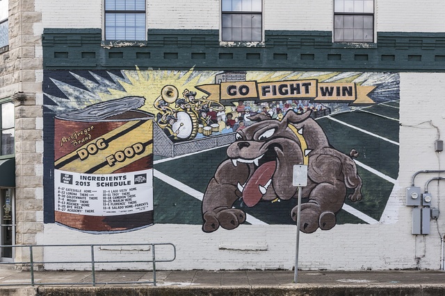 Creative display of the local high school's football team schedule on a building in little McGregor in McLennon County, Texas