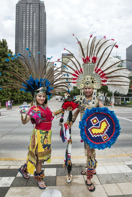 Dancers Itzel Maya, left, and Eduardo Gutierrez, pause between performances at Klyde Warren Park in Dallas, Texas, which opened in 2012 in the city's arts district
