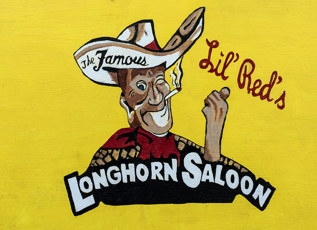 "Decorative sign (""The Famous Lil' Red's Longhorn Saloon"") inside Lil' Red's Longhorn Saloon in the Stockyards District of Fort Worth, Texas"