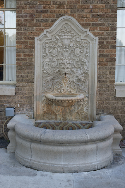 Decorative terracotta fountain on the facade of the Faust Hotel in New Braunfels, Texas, near San Antonio