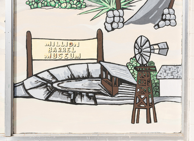 "Detail of mural depicting local history, including the era of an oil boom in which the Shell Oil Company created a giant, open oil storage tank that later became a local museum attraction the ""Million-Barrel Museum"" in Monahans, Texas"