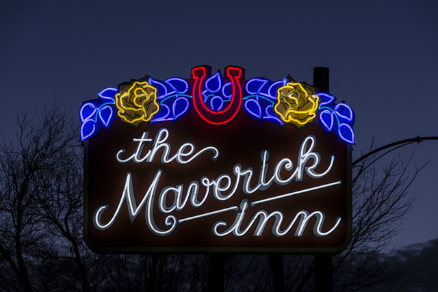 Dusk shot of a neon sign for the Maverick Inn in Alpine, Texas