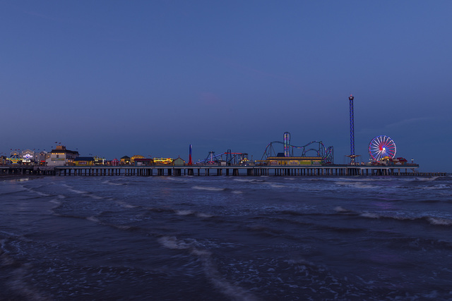 Dusk shot of the Galveston Island Historic Pleasure Pier, an amusement park in Galveston, Texas
