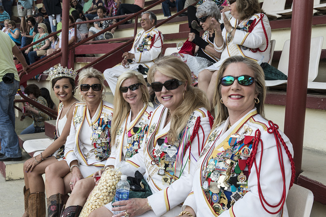 """Five members of the San Antonio Fiesta court take in a Mexican-style rodeo, or Charreria, at """"A Day in Old Mexico,"""" part of the annual, monthlong Fiesta celebration in San Antonio, Texas. They are, left to right, Marial Garza, Denise Smith, Jen Tyson, Lisa Dante, and Darcie Payne"""