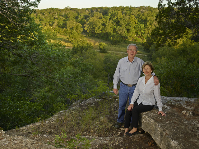Former U.S. President George W. Bush and former first lady Laura Bush at one of their favorite overlooks on their 1,600-acre ranch near Crawford in McLennon County, Texas
