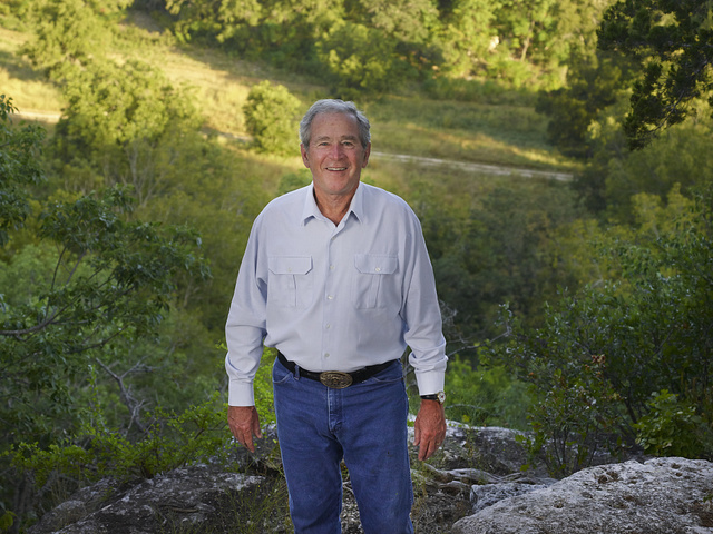 "Former U.S. President George W. Bush at a canyon overlook on his 1,600-acre ranch, site of the ""Texas White House"" during their visits there during the Bush presidency, near Crawford in McLennon County, Texas. Mr. Bush enjoys hiking and riding his mountain bike on a rocky trail near this site"