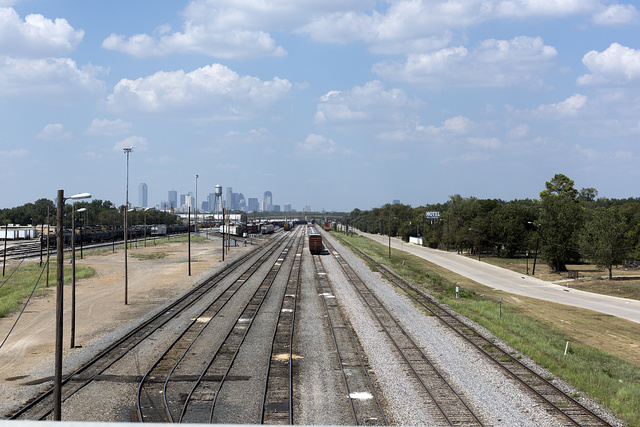 Freight yard in the southern reaches of Dallas, Texas. The Dallas skyline is in the distance