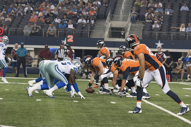 Game images from a contest between the National Football League Dallas Cowboys and the Denver Broncos at the Cowboys' home field AT&T Stadium in Arlington, Texas