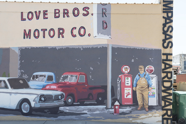 """Generations,"" one of a series of murals in Lampasas, Texas, depicting businesses that have occupied a corner of the town"