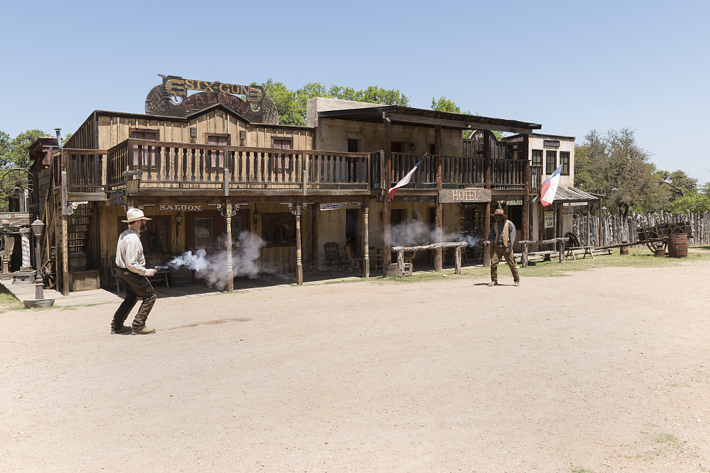 """Gunfight"" at the Enchanted Springs Ranch, a working ranch in Boerne, Texas, whose Old West Town is often used in movies and videos"