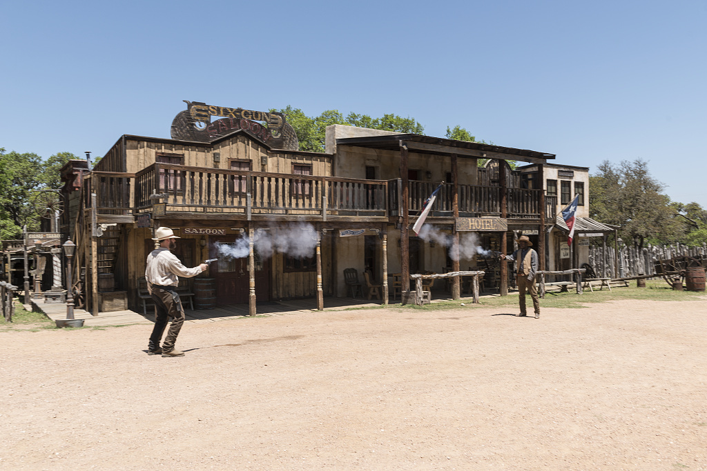 """""""Gunfight"""" at the Enchanted Springs Ranch, a working ranch in Boerne, Texas, whose Old West Town is often used in movies and videos"""