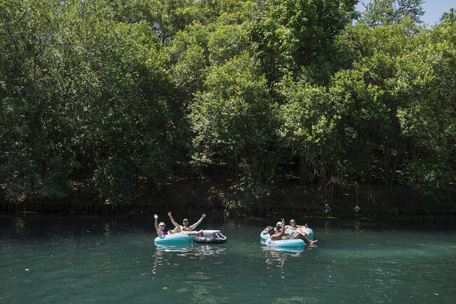 (Inner) Tubing is almost a Texas passion come summertime. These participants enjoy the water in Prince Solms Park on the Comal River in New Braunfels, near San Antonio, Texas