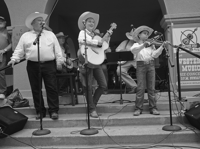 Jack Phillips, a nine-year-old fiddling prodigy, joins older performers in the Cowtown Opry in the Stockyards District of Fort Worth, Texas