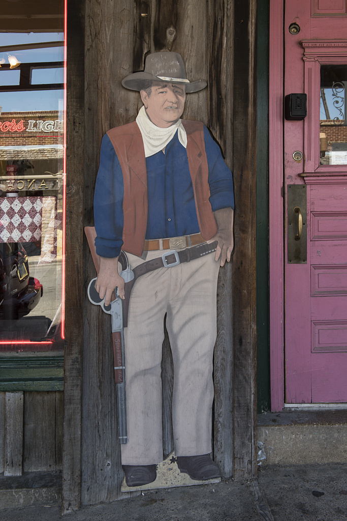 John Wayne-like street figure outside the Star Cafe in the Stockyards District of Fort Worth, Texas