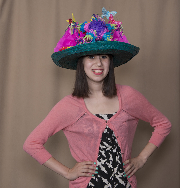 """Julia Gonzales, a student at the the Academy of Careers and Technologies Charter School in San Antonio, Texas, models her creation exhibited in the """"Hats Off to Fiesta!"""" event, sponsored by the University of Texas at San Antonio's Institute of Texan Cultures, as part of the month-long Fiesta San Antonio celebration"""