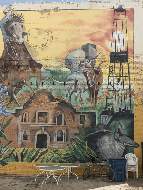 Large mural on an exterior wall of the building housing the Log Cabin Collectibles store in downtown Cisco, Texas