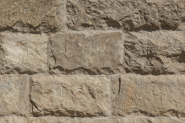 Limestone blocks in the Old Jail Art Center in Albany, Texas, seat of Shackelford County. Initials on many of the stones show masons' claims for work