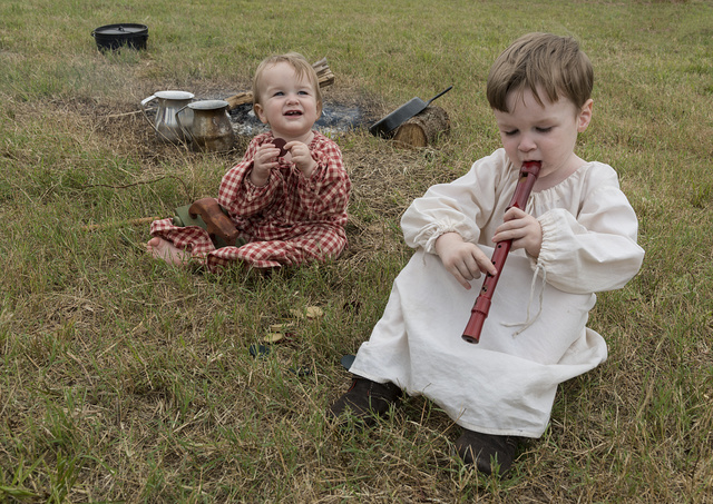 Little Davan and Whit Cullen Maloney soak up the scene in the Mexican encampment at the annual Battle of San Jacinto Festival and Battle Reenactment, a living-history retelling and demonstration of the historic Battle of San Jacinto, La Porte, Texas