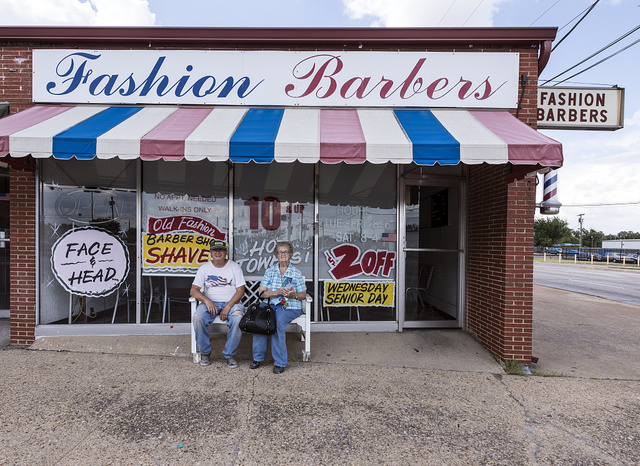 Marvin Gallia and Lois Snyder outside Ms. Snyder's barber shop in downtown Mesquite, Texas