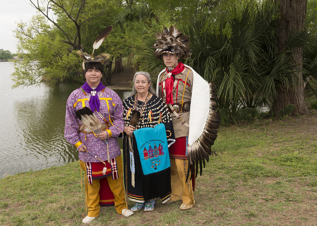Matthew De Luna Banda, left, and his cousin, Andrew De Luna, flanking their grandmother, Rose Mary De Luna, are dancers at the Celebrations of Traditions Pow Wow, an official Native American Pow Wow that is part of the annual, month-long Fiesta San Antonio in Texas