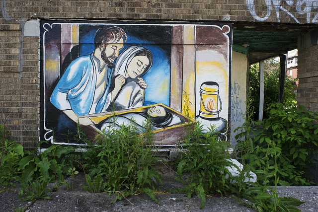 "McClellan at Goethe, Detroit, 2014.  Nativity scene painted on the ruins of an apartment building.  Berry, the postman, said, ""The neighborhood is being blessed, the area is so bad that they could use a blessing.""  Kat, the lady that lives across the street hired a sign painter.  The Goethe Building erected in 1924, is according to the postman ""Not so much the eyesore that used to be"" explaining that ""The murals on it are about faith"""