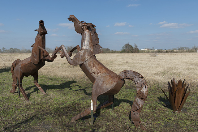 Metal figures at Rustic Center and Interiors, a rustic-furniture store along U.S. Highway 290 in Washington County, Texas, east of Brenham