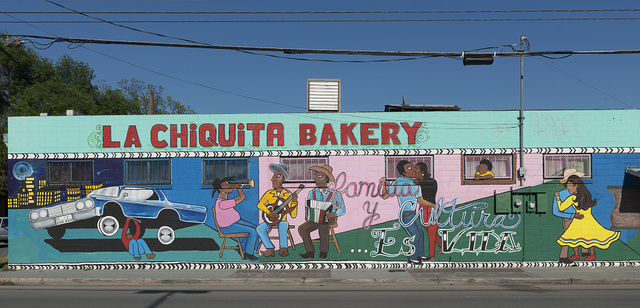Mural on side of La Chiquita Bakery depicting Mexican-American family life in San Antonio, Texas