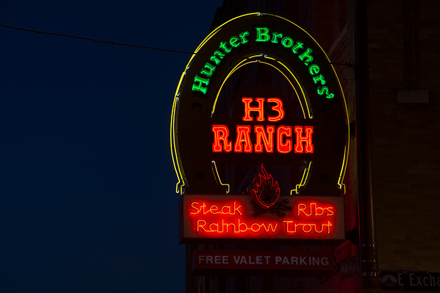 Neon sign for the Hunter Brothers' H3 Ranch steakhouse restaurant in Fort Worth, Texas