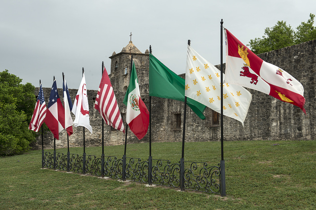 Nine flags fly outside the Presidio La Bahia in Goliad, Texas. They represent the flags of six entities that have ruled Texas territory (Spain, France, Mexico, Republic of Texas, Confederate States of America and United States of America), plus three representing revolutionary forces that briefly occupied the historic fort