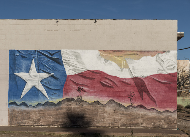 Now-incomplete depiction of a Texas flag on a building in Van Horn, Texas