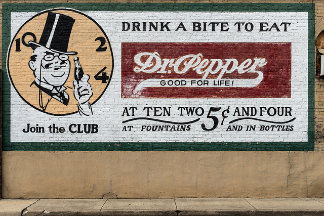 Old Dr. Pepper advertising sign on a downtown building in Pittsburg, Texas
