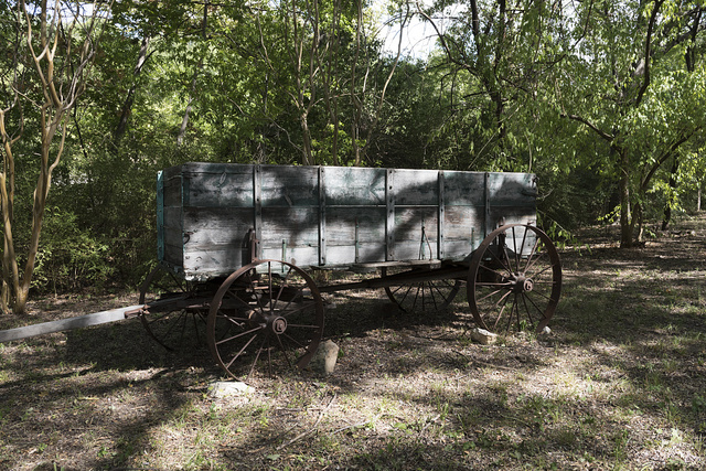 Old freight wagon on the grounds of Log Cabin Village, a house museum consisting of saved rural cabins moved to a central site in Fort Worth, Texas