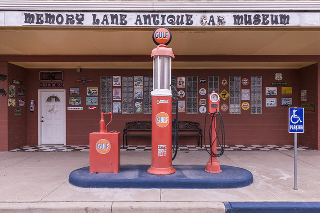 Old gasoline pumps outside a car museum in Pecos, the seat of Reeves County, Texas