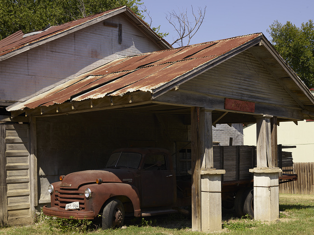 "Old truck under an older shed overhang in Italy, Texas. Gabriel J. Penn, postmaster in Waxahachie, 15 miles away, named the town in 1880 because, he said, its climate was much like that found in ""sunny Italy"""