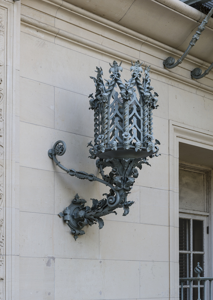 Outdoor sconce on Battle Hall at the University of Texas at Austin. Austin, Texas