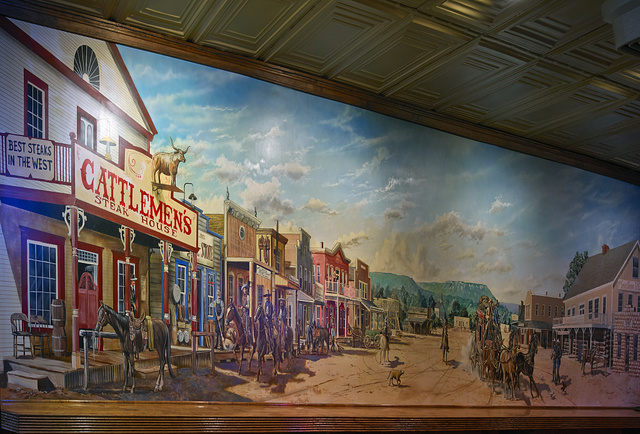 Part of a colorful western-themed mural, one of several inside the Cattlemen's Steakhouse in the Stockyards District of Fort Worth, Texas
