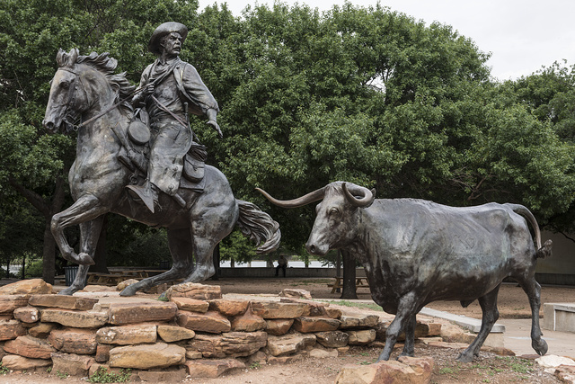"""Part of Robert Summers's sculpture, """"The Waco Chisholm Trail Heritage,"""" near the historic Waco Suspension Bridge, now a pedestrian and bicyclists' bridge across the Brazos River in Waco, Texas"""