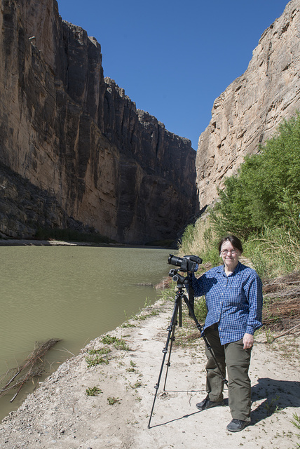 Photographer Carol M. Highsmith pauses between clicks of her Phase One 80-megapixel professional camera at the Santa Elena Canyon, deep in Big Bend National Park in Brewster County, Texas. A sheer rock wall in Mexico is to the left, one in the United States to the right