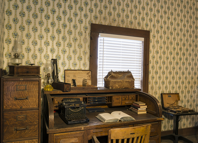 Physician's desk in the back room of the combination drug store-medical office the Spindletop-Gladys City Boomtown park, Beaumont, Texas